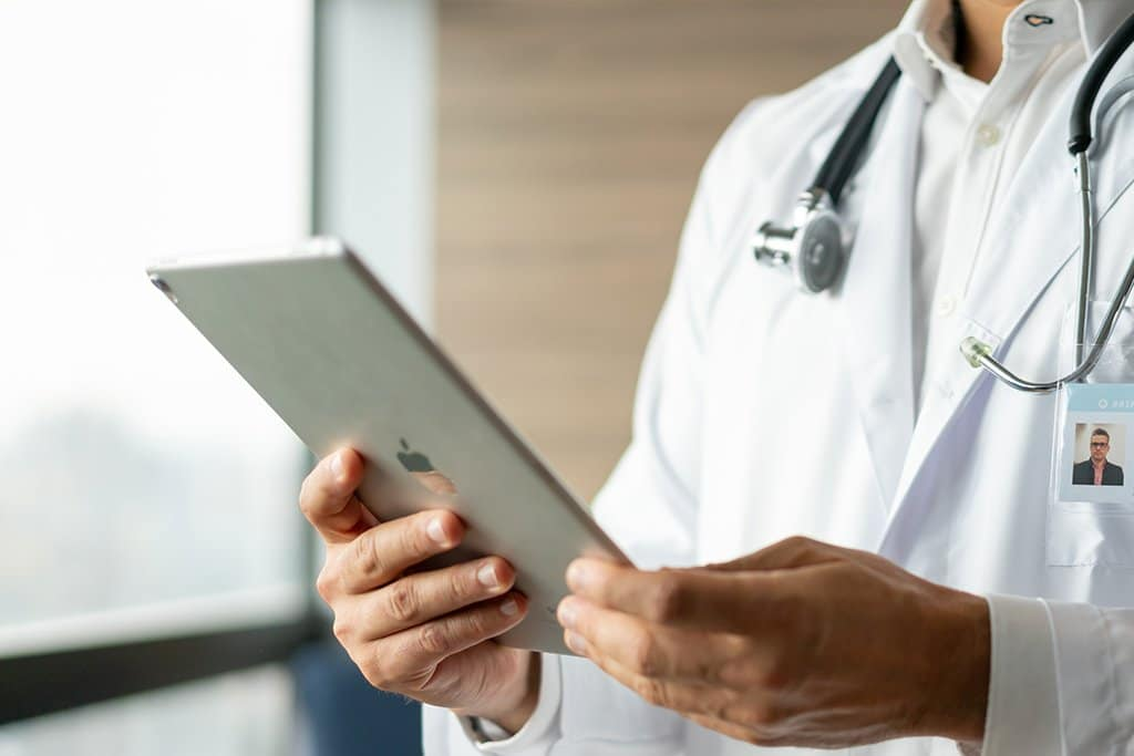 doctor, holding tablet device