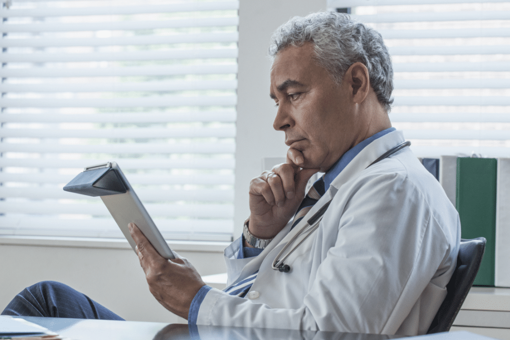 doctor, reading, tablet